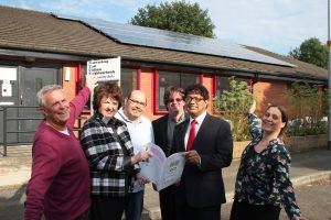 Andy Hunt (centre) with members of Oldham Community Power at the NEON Community Hub