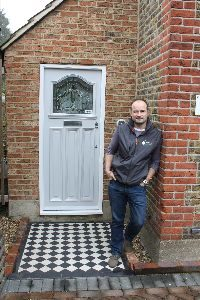 Russell Smith outside his first retrofitted demo house