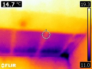 Thermal camera image showing cold rectangles where there is insulation missing in the bedroom ceiling